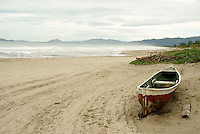 Boat on a rough Caribbean beach near Tela, Honduras...