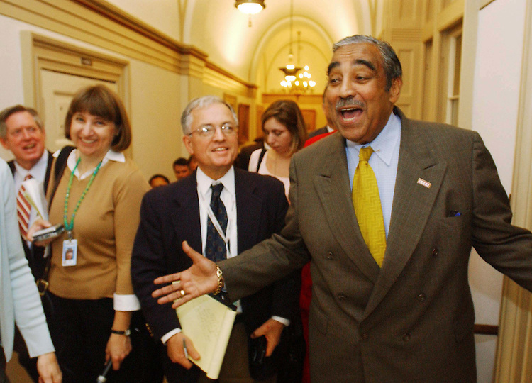 10/30/03.MEDICARE CONFERENCE--House ranking Democrat Charles B. Rangel, D-N.Y., followed by other Democrats and a swarm of reporters, leaves the hall where Chairman Bill Thomas, R-Calif., hosts the Medicare conference in his hideaway. Thomas would not allow Rangel, who is a member of the conference, and others to attend, even though at least two Democratic senators are regular participants in negotiations..CONGRESSIONAL QUARTERLY PHOTO BY SCOTT J. FERRELL