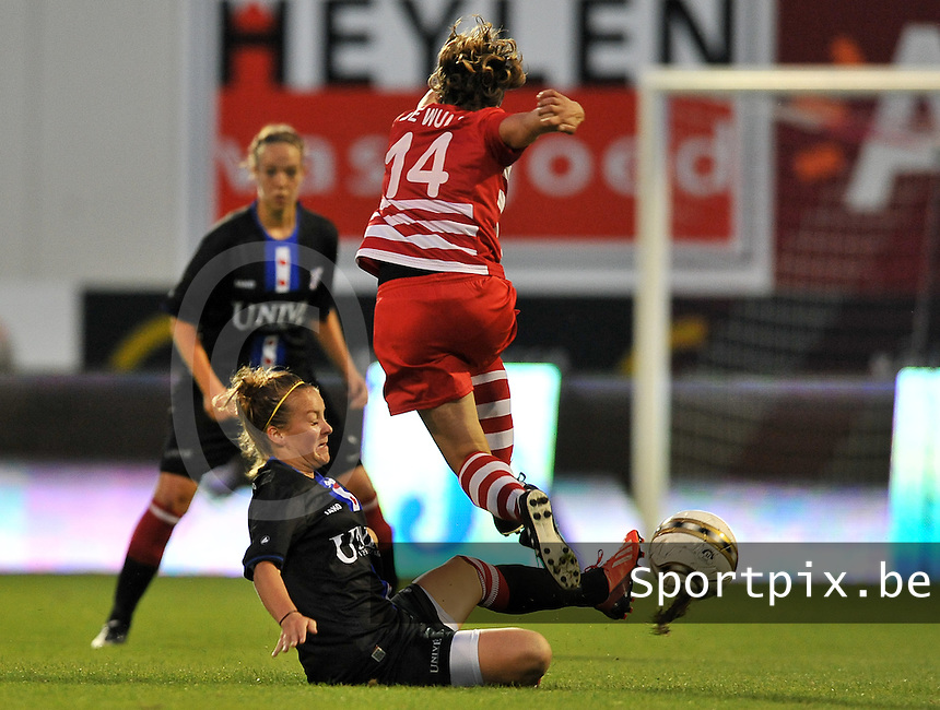 20130903 - ANTWERPEN , BELGIUM : Heerenveen's Ingrid Schuiten pictured tackling Antwerp Angelique De Wulf during the female soccer match between Royal Antwerp FC Vrouwen and SC Heerenveen at the BOSUIL STADIUM , of the second matchday in the BENELEAGUE competition. Tuesday 3 September 2013. PHOTO DAVID CATRY