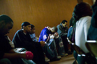 New York, USA - Members of the Hip-Hop Choir pray during rehearsal at the Greater Hood Memorial AME Zion Church, home of the Hip-Hop Church, in Harlem, New York, USA, 26 January 2005. Photo Credit: David Brabyn.