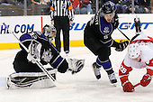 Jonathan Quick (Los Angeles Kings, #32) catches the puck while Drew Doughty (Los Angeles Kings, #8) crashes Jiri Hudler (Detroit Red Wings, #26) during ice-hockey match between Los Angeles Kings and Detroit Red Wings in NHL league, February 28, 2011 at Staples Center, Los Angeles, USA. (Photo By Matic Klansek Velej / Sportida.com)