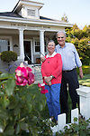 Roy and Penny Lave pose for a photo in front of the Los Altos Community House.<br />