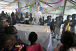 Father Mike Bassano, a Maryknoll priest from the United States, gathers children around the altar as he celebrates mass in a makeshift chapel inside a United Nations base in Malakal, South Sudan. More than 20,000 civilians have lived inside the base since shortly after the country's civil war broke out in December, 2013, and renewed fighting in 2015 drove an additional 5,000 people into the relative safety of the camp. Bassano lives in the camp to accompany the people there.