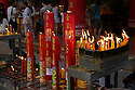 TH00233-00...THAILAND - During the Vegetarian Festival, visitors to the temples in China Town light insence and candles and often wear white.