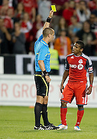 Toronto FC forward Joao Plata #7 receives a yellow card from the referee during an MLS game between the Vancouver Whitecaps FC and the Toronto FC at BMO Field in Toronto on June 29, 2011..Toronto FC won 1-0..