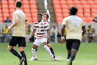 Houston, TX - Friday December 11, 2016: Bryce Marion (7) of the Stanford Cardinal gains control of the ball against the Wake Forest Demon Deacons at the NCAA Men's Soccer Finals at BBVA Compass Stadium in Houston Texas.
