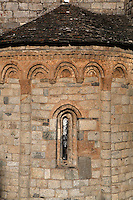 Detail of decorative Lombard arches and narrow window of a semicircular apse of Sant Climent de Taull church, 1123, consecrated by Ramon Guillem, the bishop of Roda, Taull, Province of Lleida, Catalonia, Spain. The building was constructed from granite blocks, the decorative elements and windows were carved in pumice. The church of Sant Climent is the largest; its characteristic Lombard architecture and interior decoration make it the symbol of Catalan Romanesque architecture. The Catalan Romanesque churches of the Vall de Boí were declared a World Heritage Site by UNESCO in November 2000. Picture by Manuel Cohen.
