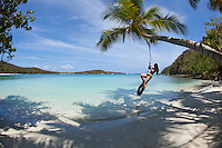 Alexander Krasny on a tire swing at  Gibney / Oppenheimer Beach.Virgin Islands National Park.St. John, U.S. Virgin Islands