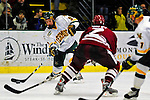 23 January 2009: University of Vermont Catamount forward Wahsontiio Stacey, a Sophomore from Kahnawake, Quebec, in action against the University of Massachusetts Minutemen during the first game of a weekend series at Gutterson Fieldhouse in Burlington, Vermont. The Catamounts defeated the visiting Minutemen 2-1. Mandatory Photo Credit: Ed Wolfstein Photo