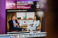 The website for the Oprah Winfrey Network (OWN) promotes her interview with Lance Armstrong to take place this evening, Thursday, January 17, 2013. Armstrong has been accused of doping and other drug use in order to win the Tour de France races.  (© Richard B. Levine)