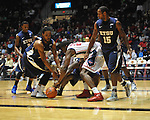 "Ole Miss' Reginald Buckner (23) vs.East Tennessee State's Kinard Gadsden-Gilliard (35), East Tennessee State's Lester Wilson (15), and East Tennessee State's Hunter Harris (20) at the C.M. ""Tad"" Smith Coliseum in Oxford, Miss. on Saturday, December 14, 2012. Mississippi won 77-55 to improve to 7-1. (AP Photo/Oxford Eagle, Bruce Newman).."