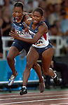 USA Women sprinter Marion Jones attempte to hand off the baton to fellow teammate Lauryn Williams in the 4 X 100 Meter Relay  at the 2004 Summer Olympic Games in Athens,Greece on Friday, August 27th, 2004.. The two mishadled the exchange and the US did not finish with Jamaica winning the Gold with Russia taking Silver and France.         DENVER POST PHOTO BY STEVE DYKES