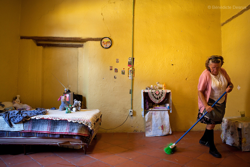 Margarita, a resident of Casa Xochiquetzal, cleans her bedroom at the shelter in Mexico City, Mexico on October 4, 2010. Casa Xochiquetzal is a shelter for elderly sex workers in Mexico City. It gives the women refuge, food, health services, a space to learn about their human rights and courses to help them rediscover their self-confidence and deal with traumatic aspects of their lives. Casa Xochiquetzal provides a space to age with dignity for a group of vulnerable women who are often invisible to society at large. It is the only such shelter existing in Latin America. Photo by Bénédicte Desrus