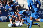 14 December 2014: Virginia's Pablo Aguilar (GUA) (below) pulls UCLA's Grady Howe (above) to the ground. The University of Virginia Cavaliers played the University of California Los Angeles Bruins at WakeMed Stadium in Cary, North Carolina in the 2014 NCAA Division I Men's College Cup championship match.
