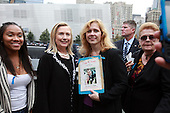 On the 10th anniversary of the September 11th terrorist attacks, United States Secretary of State Hillary Rodham Clinton (left), wife of former U.S. President Bill Clinton, poses with Carolyn Bilelis, who lost her brother Craig Staub in the 9/11 attacks, at opening day of the September 11th Memorial at the World Trade Center site in New York, New York on September 11, 2011..Credit: Jefferson Siegel / Pool via CNP