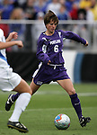 Portland's Angie Woznuk scores the first goal of the game on this shot. The University of Portland Pilots led the UCLA Bruins 3-0 at halftime in the NCAA Division I Women's Soccer Championship game at Aggie Soccer Stadium in College Station, TX, Sunday, December 4, 2005.
