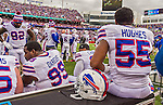 19 October 2014: Buffalo Bills defensive end Jerry Hughes waits out a play review with teammates on the sidelines in the first quarter against the Minnesota Vikings at Ralph Wilson Stadium in Orchard Park, NY. The Bills defeated the Vikings 17-16 in a dramatic, last minute, comeback touchdown drive. Mandatory Credit: Ed Wolfstein Photo *** RAW (NEF) Image File Available ***