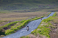Motorcyclists on Kylemore Pass by the Twelve Bens mountains, Connemara, County Galway, Ireland