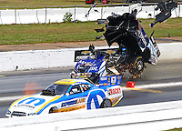 May 18, 2014; Commerce, GA, USA; NHRA funny car driver Tommy Johnson Jr (far lane) explodes the carbon fiber body off his car alongside Matt Hagan during the Southern Nationals at Atlanta Dragway. Johnson was uninjured in the explosion. Mandatory Credit: Mark J. Rebilas-USA TODAY Sports