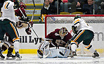 "19 January 2007: Boston College goaltender Corey Schneider from Marblehead, MA, makes a save during a Hockey East matchup against the University of Vermont at Gutterson Fieldhouse in Burlington, Vermont. The UVM Catamounts defeated the BC Eagles 3-2 before a record setting 50th consecutive sellout at ""the Gut""...Mandatory Photo Credit: Ed Wolfstein Photo."