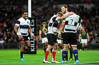 Luke Morahan of the Barbarians celebrates his try with team-mates. Killik Cup International match, between the Barbarians and South Africa on November 5, 2016 at Wembley Stadium in London, England. Photo by: Patrick Khachfe / JMP