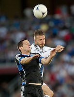 Stanford, California - Saturday June 30, 2012: Sam Cronin and David Beckham jump for the ball during a at Stanford Stadium, Stanford, Ca.San Jose Earthquakes defeated Los Angeles Galaxy,  4 to 3