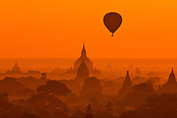 Hot air balloon flying over the temples of Bagan, Burma at sunrise