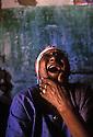 Toothless elderly black woman laughes, Pernambuco, northeastern  Brazil.