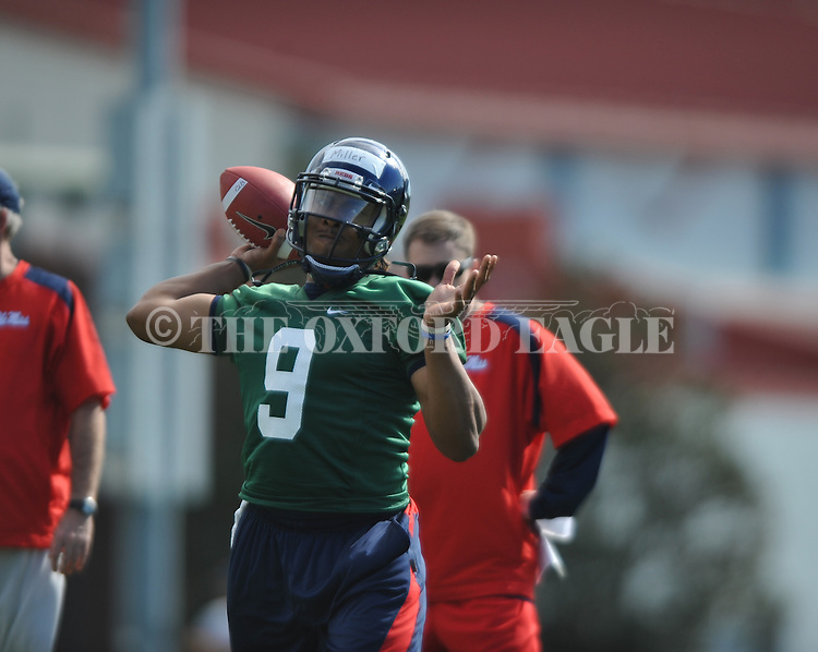Quarterback Miller goes through a drill as Mississippi began spring practice in Oxford, Miss. on Friday, March 23, 2012. (AP Photo/Oxford Eagle, Bruce Newman)