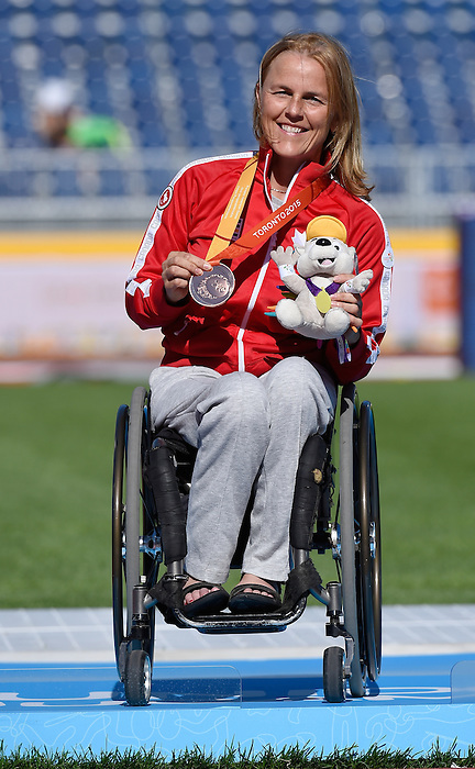 Toronto, ON - Aug 12 2015 - Diane Roy receives her Bronze medal for the Women's 400m T54 in the CIBC Athletics Stadium during the Toronto 2015 Parapan American Games  (Photo: Matthew Murnaghan/Canadian Paralympic Committee)