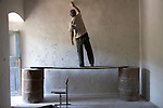 A man renovates a house in Martakert, Nagorno-Karabakh.  The region saw heavy fighting during the war and was claimed by both sides at various points.   Now, more than a decade later, some people are finally able to rebuild.