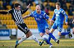 St Johnstone v St Mirren....22.01.11  .Sam Parkin is tackled by Darren McGregor.Picture by Graeme Hart..Copyright Perthshire Picture Agency.Tel: 01738 623350  Mobile: 07990 594431