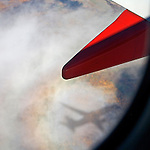 Southwest Airlines Boeing 737 shadow in clouds