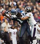 Baltimore Ravens cornerback Cory Williams, right, knocks the ball away from Seattle Seahawks wide receiver Sidney Rice during the fourth quarter against the Baltimore Ravens at  CenturyLink Field in Seattle, Washington on November 13, 2011. The Seahawks beat the Ravens 22-17.  ©2011 Jim Bryant Photo. All Rights Reserved.