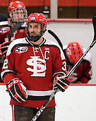 Aaron Bogosian (St. Lawrence - 32) - The Harvard University Crimson defeated the St. Lawrence University Saints 4-3 on senior night Saturday, February 26, 2011, at Bright Hockey Center in Cambridge, Massachusetts.