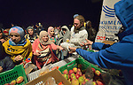 Refugees and migrants--often including entire families--receive food and blankets from Hungarian Interchurch Aid, a member of the ACT Alliance, as they leave the Hungarian town of Hegyeshalom late at night and prepare to cross the border into Austria. Hundreds of thousands of refugees and migrants flowed through Hungary in 2015, on their way to western Europe from Syria, Iraq and other countries.