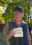 Old Bethpage, New York, U.S. 29th September 2013. Robert Stuhmer, of Garden City Park, holds admission ticket passes at The Long Island Fair. A yearly event since 1842, the county fair now is held at a reconstructed fairground at Old Bethpage Village Restoration.