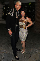BEVERLY HILLS, CA, USA - MARCH 28: KUBA Ka, Christina DeRosa at the Versace Unveiling Of The 1st Pop Recording Artist Superhero - KUBA Ka's Performance Outfits. Designed by the legendary fashion hosuse - Donatella Versace. For the Benefit of the Face Forward Foundation (Plastic Surgery for Destroyed Faces from Violence). Pop entertainer TV personality KUBA Ka, together with VERSACE, unveiled Kuba Ka's new Versace images, for the First Pop Artist/Superhero of the World. He has become the inspiration of Donatella's newest and wildest creations and will celebrate the launch of his new power house conglomerate - KUBA Ka Empire Inc. in collaboration with the sensational fashion house - VERSACE on Friday, his birthday at a red carpet media and celebrity event at the luxurious Peninsula Hotel in Beverly Hills held at the Peninsula Hotel on March 28, 2014 in Beverly Hills, California, United States. (Photo by Xavier Collin/Celebrity Monitor)
