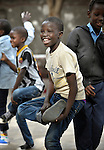 A refugee boy enjoys physical education class in a school operated by St. Andrew's Refugee Services in Cairo, Egypt. Located at St. Andrews United Church of Cairo, the program is supported by Church World Service.