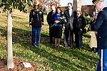 The Gonzalez Family stands at the tree dedicated to SPC Michael Gonzalez, killed in Iraq