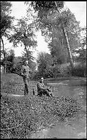 BNPS.co.uk (01202 558833)<br /> Pic: PoppylandPublishing/BNPS<br /> <br /> Sergeant Stanley took this image of soldiers taking time out to do some fishing.<br /> <br /> Left to gather dust in a darkened attic for decades, they are the diaries and secret photos documenting the hell and horrors of the battlefields of the First World War.<br /> <br /> It wasn't until Heather Brodie had a clear out that the unknown but remarkable archive kept by her late father, Sergeant Horace Reginald Stanley, came to light.<br /> <br /> His emotive diary and remarkable images taken with a camera he smuggled into the trenches paint a harrowing picture of life on the front line at Ypres and The Somme.<br /> <br /> He wrote of how he witnessed comrades next to killed by German shelling and described the hopelessness and terror one felt as the men waited for their turn to be hit.<br /> <br /> His writings were even more poignant as his elder brother Frederick was killed after his dugout suffered a direct hit near Arras.