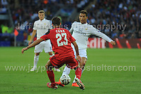 Cardiff City Stadium, Cardiff, South Wales - Tuesday 12th Aug 2014 - UEFA Super Cup Final - Real Madrid v Sevilla - <br /> <br /> Sevilla&rsquo;s Coke challenges Real Madrid&rsquo;s Christiano Ronaldo. <br /> <br /> <br /> <br /> <br /> Photo by Jeff Thomas/Jeff Thomas Photography