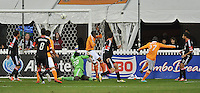 Houston Dynamo midfielder Boniek Garcia (27) scores against D.C. United goalkeeper Bill Hamid (28) D.C. United tied The Houston Dynamo 1-1 but lost in the overall score 4-2 in the second leg of the Eastern Conference Championship at RFK Stadium, Sunday November 18, 2012.