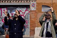 Roma 20 Marzo 2015<br /> Eclissi solare parziale al quartiere San Lorenzo. La gente si riunita questa mattina in Piazza Immacolata, per osservare  l'eclissi solare parziale. Alcune persone guardano  l'eclissi solare parziale attraverso le radiografie.<br /> <br /> Rome March 20, 2015<br /> Partial solar eclipse. People gather this morning in Piazza Immacolata, District San Lorenzo, to get a rare glimpse of the solar eclipse. People looks at a partial solar eclipse through an X-ray<br /> .
