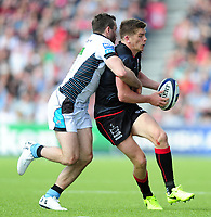 Owen Farrell of Saracens is tackled by Tommy Seymour of Glasgow Warriors. European Rugby Champions Cup Quarter Final, between Saracens and Glasgow Warriors on April 2, 2017 at Allianz Park in London, England. Photo by: Patrick Khachfe / JMP