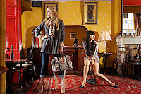 NO REPRO FEE.30/8/2010. AWEAR AUTUMN COLLECTION.EXCLUSIVE PICTURES FOR IRISH TIMES.(To accompany Deirdre McQuillans article) Yomiko Chen & Sarah Morrissey model a selection of dresses from A|wear's new autumn '10 collection at Kehoes Pub in Dublin. Sarah wears Swing grey coat - EUR80, Printed Blouse - EUR30 Skinny denims - EUR30 and Satchel bag - EUR35 .Yomiko Chen wears Printed dress - EUR45 and a Black studded bag - EUR25 The collection arrives instore and on www.awear.com from this week.  Picture James Horan/Collins Photos