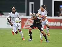 Nick De Leon (18) of D.C. United goes against Lee Nguyen (24) of the New England Revolution. The New England Revolution defeated D.C. Untied 2-1, at RFK Stadium, Saturday July 27 , 2013.