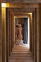 A pile of wood can be concealed behind a simple curtain in the wooden entrance hall