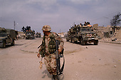 Al Busayyah, Southern Iraq<br /> February 28, 1991<br /> <br /> An American military engineering division clears Al Busayyah of Iraqi soldiers and mines.
