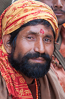 Pashupatinath, Nepal.  Sadhu (Holy Man) at Nepal's Holiest Hindu Temple.  He wears a tikka on his forehead, a blessing and a mark of Hinduism.
